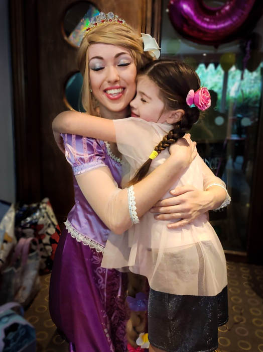 Princess Appearances Essex with princess hugging a young birthday girl